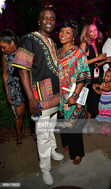Akon and Kinequeye Thiam attend 2016 Passport Experience at Centennial Olympic Park on August 13 2016 in Atlanta Georgia