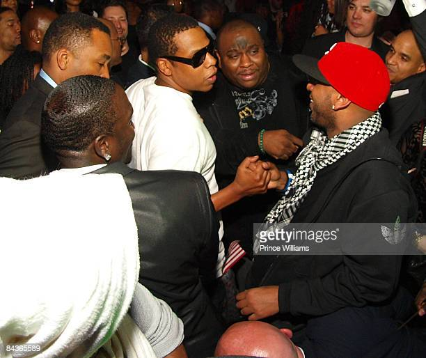 Akon JayZ Mike Taylor and Alex Gidewon converse as they leave the stage at Young Jeezy's 'Presidential Status' Inauguration Ball at Club Love on...