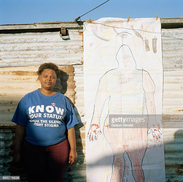 Akona Jazi poses with her body map outside her tin shack in the Khayelitsha squatter community She was diagnosed as HIV positive in 2000 when she...