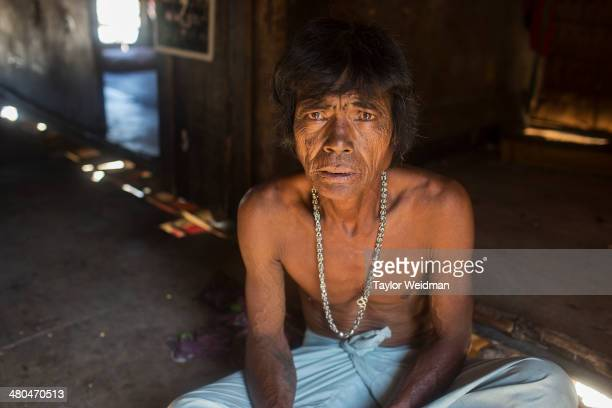 Akoo an indigenous Moken man in his home in Ko Surin National Park Often called sea nomads or sea gypsies the Moken are a seafaring people who for...