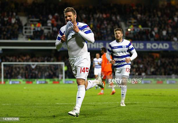 Akos Buzsaky of Queens Park Rangers celebrates scoring his side's third goal during the Barclays Premier League match between Queens Park Rangers and...