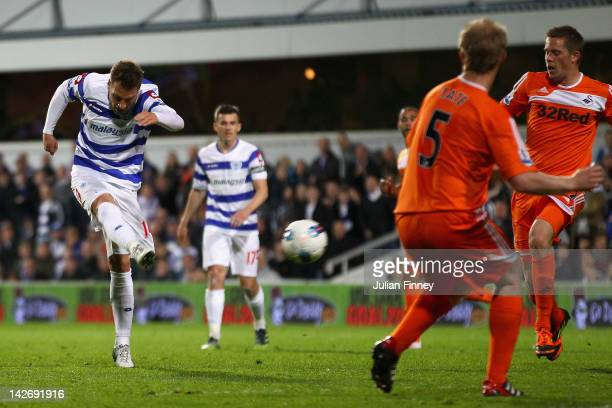 Akos Buzsaky of Queens Park Rangers scores his side's third goal during the Barclays Premier League match between Queens Park Rangers and Swansea...