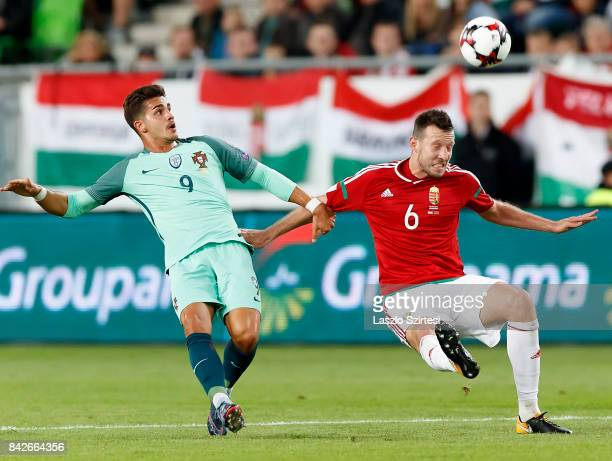 Akos Elek of Hungary competes for the ball with Andre Silva of Portugal during the FIFA 2018 World Cup Qualifier match between Hungary and Portugal...