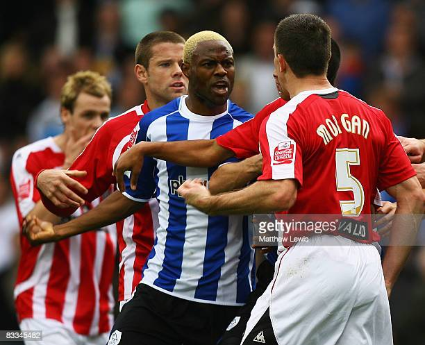 Akpo Sodje of Sheffield Wednesday and Chris Morgan of Sheffield United have words during the CocaCola Championship match between Sheffield Wednesday...