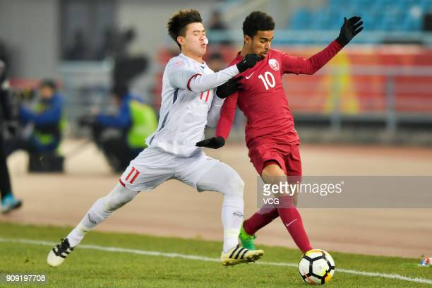 Akram Afif of Qatar and Do Duy Manh of Vietnam compete for the ball during the AFC U23 Championship semifinal match between Qatar and Vietnam at...