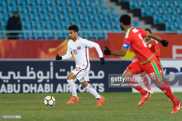 Akram Afif of Qatar runs with the ball during the AFC U23 Championship China 2018 Group A match between Oman and Qatar at Changzhou Sports Center on...