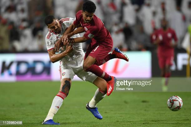 Akram Hassan Afif of Qatar and Ismail Ahmed Mohamed of United Arab Emirates compete for the ball during the AFC Asian Cup semi final match between...