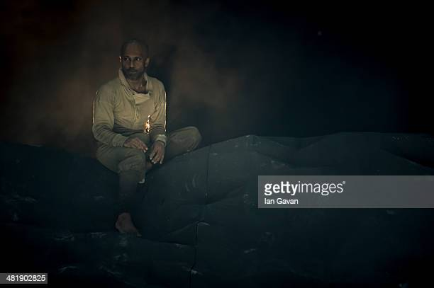 Akram Khan performs on stage during a dress rehearsal of the English National Ballet's Lest We Forget at the Barbican Centre on April 1 2014 in...