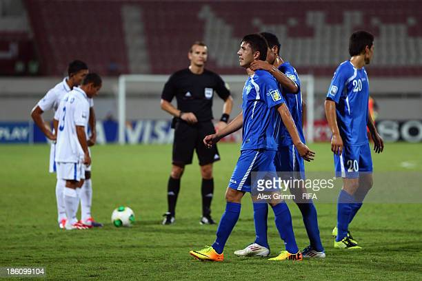 Akramjon Komilov of Uzbekistan leaves the pitch after being sent off by referee Pavel Kralovec during the FIFA U17 World Cup UAE 2013 Round of 16...