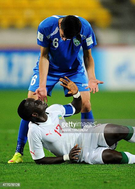 Akramjon Komilov of Uzbekistan offers to help up Roger Gomis of Senegal but is refused during the FIFA Under20 World Cup football quarterfinal match...