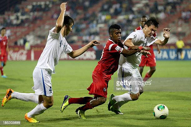 Akramjon Komilov of Uzbekistan tries to tackle Milciades Molina of Panama during the Group C FIFA U17 World Cup between Panama and Uzbekistan at...