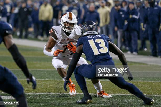 Akron Zips defensive back Denzel Butler prepares to tackle Bowling Green Falcons running back Bryson Denley after Denley made a catch during the...