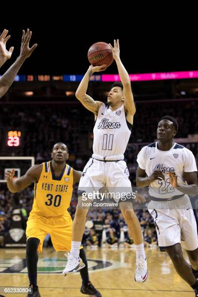 Akron Zips G Tavian DunnMartin shoots during the first half of the MAC mens basketball tournament championship game between the Kent State Golden...