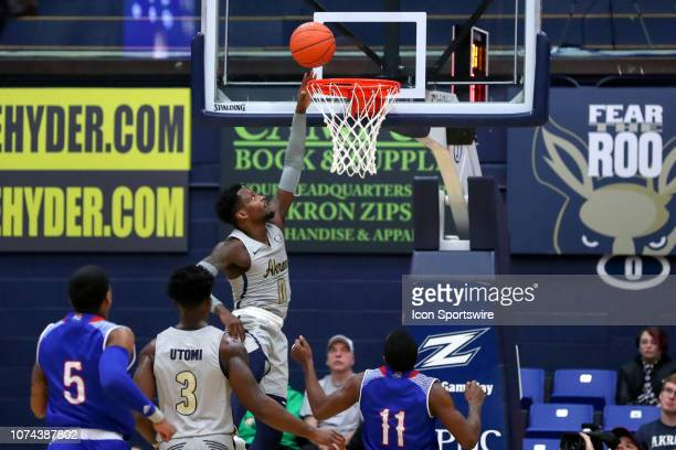 Akron Zips guard Jimond Ivey scores with a layup during the first half of the college basketball game between the Tennessee State Tigers and Akron...