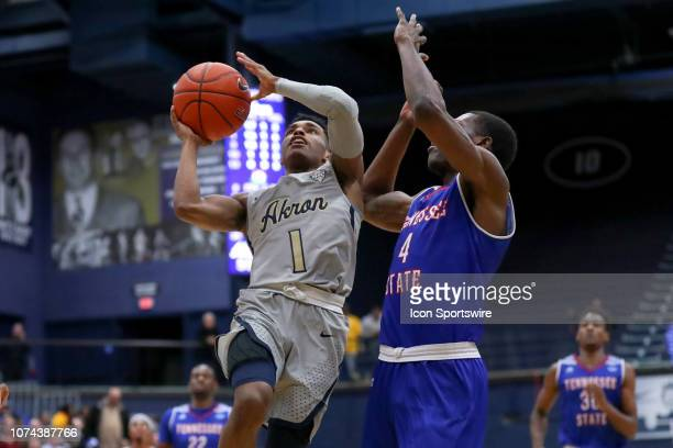Akron Zips guard Loren Cristian Jackson shoots as Tennessee State Tigers forward Damarri Moore defends during the second half of the college...