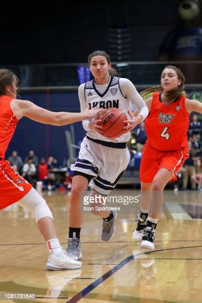 Akron Zips guard Megan Sefcik drives to the basket between Bowling Green Falcons guard Andrea Cecil and Bowling Green Falcons guard Madisen Parker...