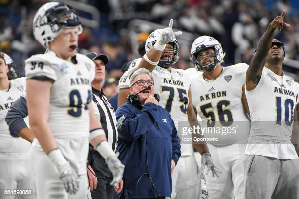 Akron Zips head coach Terry Bowden and his team point to the video board on a turnover during the Akron Zips versus Toledo Rockets MAC Championship...
