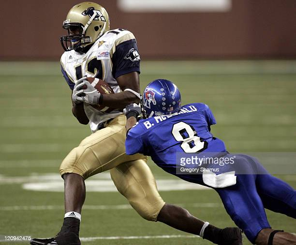 Akron Zips Jabari Arthur turns up field after making a catch over Memphis Tigers Brandon McDonald during the Motor City Bowl at Ford Field in...