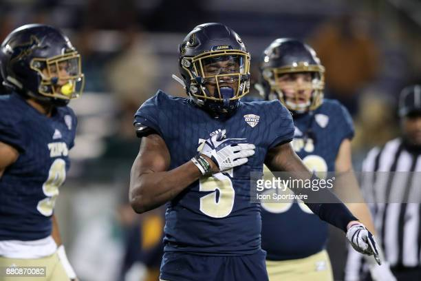 Akron Zips linebacker Ulysees Gilbert III celebrates after making a tackle during the fourth quarter of the college football game between the Kent...