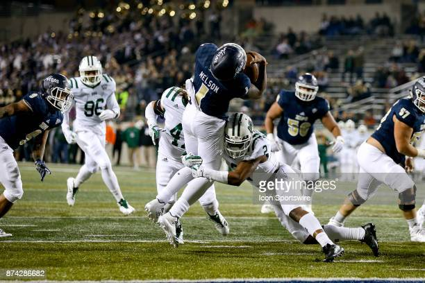 Akron Zips quarterback Kato Nelson is stopped short of the goal line by Ohio Bobcats cornerback Mayne Williams during the first quarter of the...