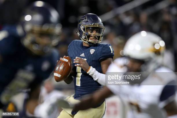 Akron Zips quarterback Kato Nelson looks to pass during the first quarter of the college football game between the Kent State Golden Flashes and the...