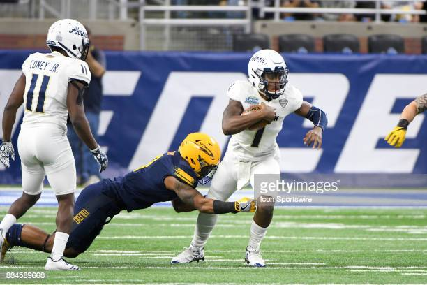 Akron Zips quarterback Kato Nelson runs for a gain during the Akron Zips versus Toledo Rockets MAC Championship Game on Saturday December 2 2017 at...