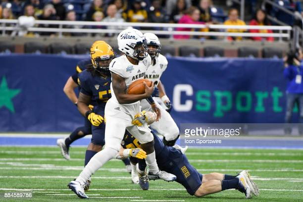 Akron Zips quarterback Kato Nelson runs upfield for a nice gain during the Akron Zips versus Toledo Rockets MAC Championship Game on Saturday...