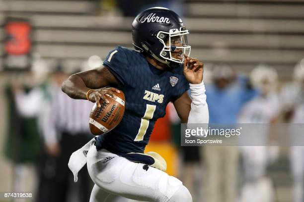 Akron Zips quarterback Kato Nelson runs with the football during the fourth quarter of the college football game between the Ohio Bobcats and Akron...