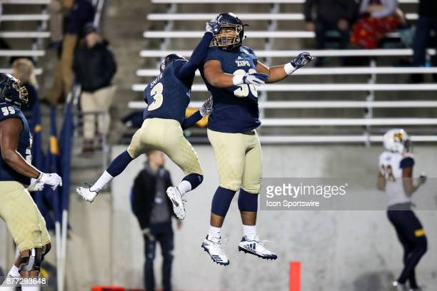 Akron Zips wide receiver Kwadarrius Smith and Akron Zips tight end Kobie Booker celebrate after Booker scored on a 25yard pass play during the first...