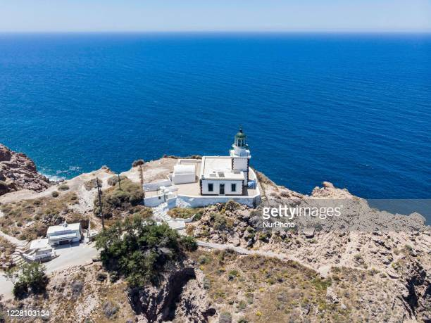 Akrotiri picturesque Lighthouse on the southern tip of the Mediterranean island Thira, Thera or Santorini in Cyclades, Aegean sea. The most famous...