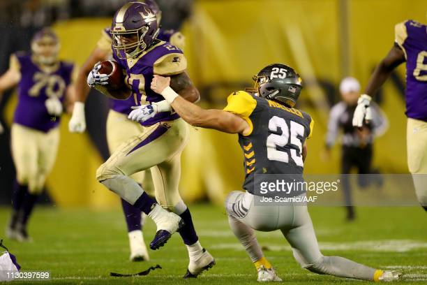 Akrum Wadley of the Atlanta Legends runs with the ball while being tackled by Ryan Moeller of the San Diego Fleet in the third quarter during the...