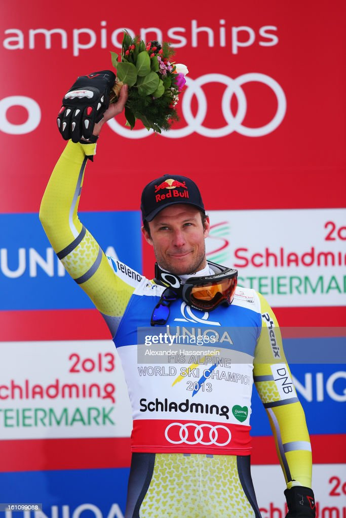 Aksel Lund Svindal of Norway celebrates at the flower ceremony after winning the Men's Downhill during the Alpine FIS Ski World Championships on February 9, 2013 in Schladming, Austria.
