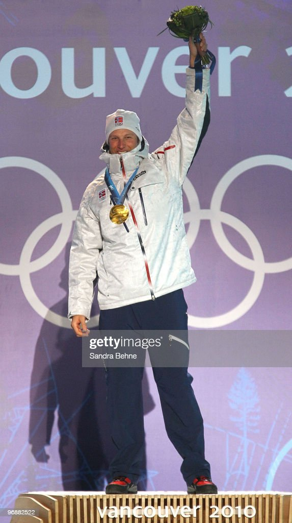 Aksel Lund Svindal of Norway celebrates his gold medal during the medal ceremony for the men's Super-G on day 8 of the Vancouver 2010 Winter Olympics at Whistler Medals Plaza on February 19, 2010 in Whistler, Canada.