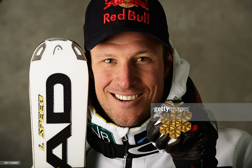 Aksel Lund Svindal of Norway celebrates with his gold medal after winning the Men's Downhill during the Alpine FIS Ski World Championships on February 9, 2013 in Schladming, Austria.