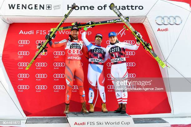 Aksel Lund Svindal of Norway takes 2nd place Beat Feuz of Switzerland takes 1st place Matthias Mayer of Austria takes 3rd place during the Audi FIS...