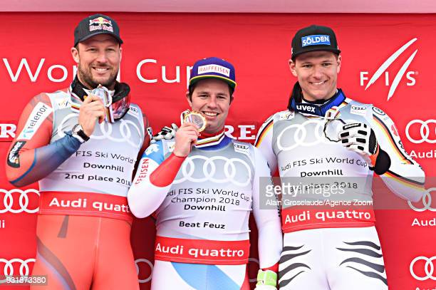 Aksel Lund Svindal of Norway takes 2nd place Beat Feuz of Switzerland wins the globe in the men downhill standing Thomas Dressen of Germany takes 3rd...