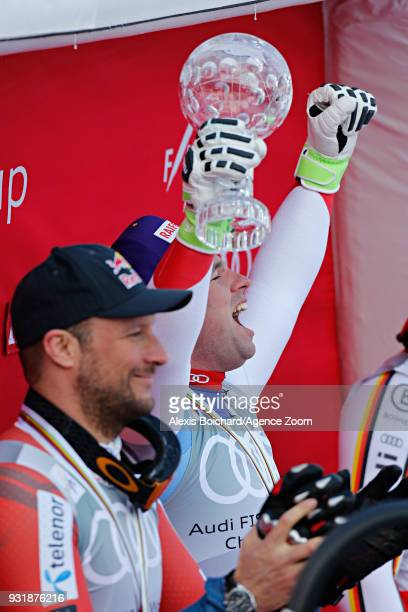 Aksel Lund Svindal of Norway takes 2nd place Beat Feuz of Switzerland wins the globe iin the men downhill standing Thomas Dressen of Germany takes...