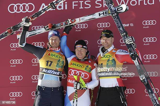 Aksel Lund Svindal of Norway takes 2nd place, Didier Cuche of Switzerland takes 1st place, Klaus Kroell of Austria takes 3rd place during the Audi...