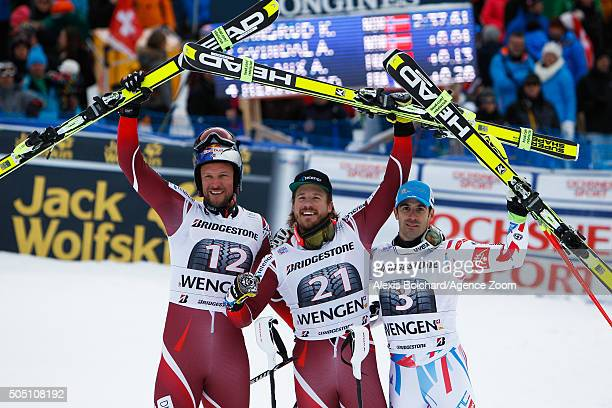 Aksel Lund Svindal of Norway takes 2nd place Kjetil Jansrud of Norway takes 1st place Adrien Theaux of France takes 3rd place during the Audi FIS...