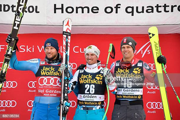 Aksel Lund Svindal of Norway takes 2nd place Max Franz of Austria takes 1st place Steven Nyman of USA takes 3rd place during the Audi FIS Alpine Ski...