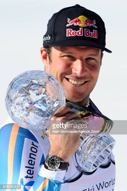 Aksel Lund Svindal of Norway wins the overall downhill World Cup globe during the Audi FIS Alpine Ski World Cup Finals Men's Downhill on March 12...