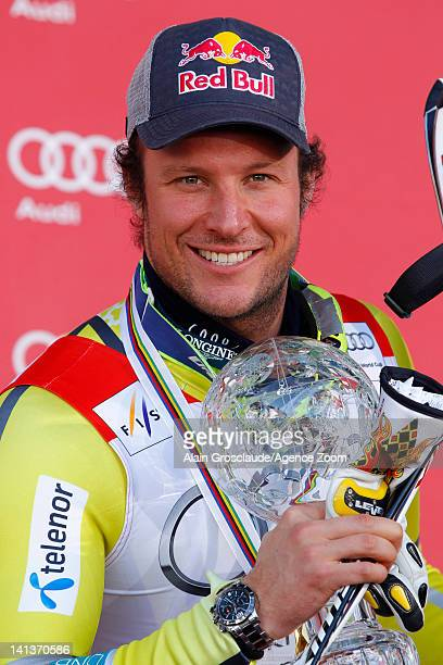Aksel Lund Svindal of Norway wins the Overall World Cup SuperG globe during the Audi FIS Alpine Ski World Cup Men's SuperG on March 15 2012 in...