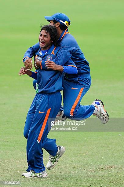 Aksh Deepnath of India celebrates with Kamal Passi of India after a Pakistan dismissal during the ICC U19 Cricket World Cup 2012 Quarter Final match...