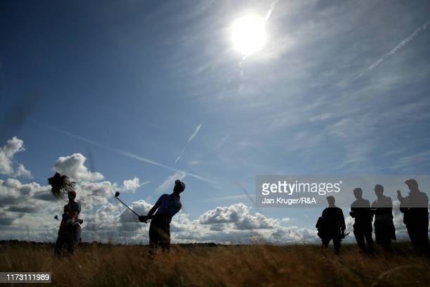 Akshay Bhatia of the United States plays a shot from the rough on the fifteenth in the foursome matches during Day 2 of the Walker Cup at Royal...