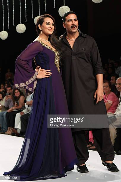 Akshay Kumar Sonakshi Sinha walk the runway in Gitanjali design on day 1 of India International Jewellery Week 2013 at the Hotel Grand Hyatt on...