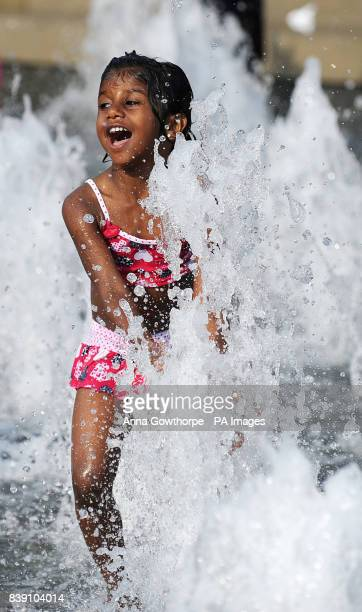 Akshiga Vigithbabu aged four plays in the water fountains outside the MIMA Gallery MiddlesbroughPicture date Saturday October 1 2011 Parts of the...