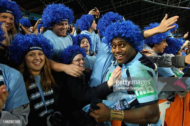 Akuila Uate of the Blues celebrates with fans after winning game two of the ARL State of Origin series between the New South Wales Blues and the...