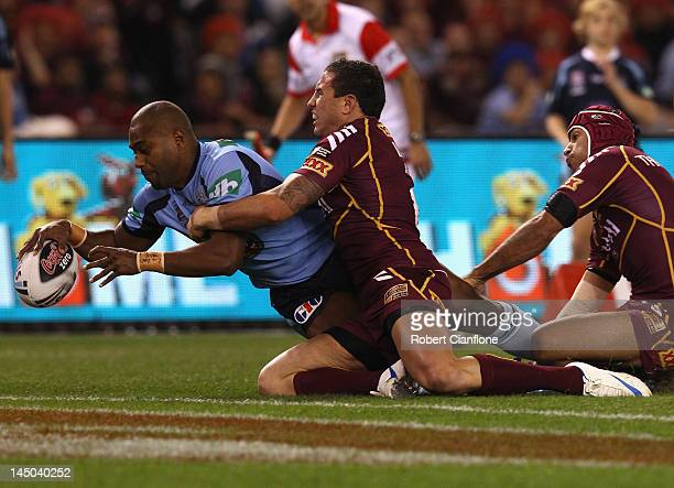 Akuila Uate of the Blues scores a try during game one of the ARL State of Origin series between the Queensland Maroons and the New South Wales Blues...