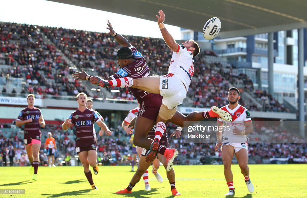 Akuila Uate of the Eagles and Jason Nightingale of the Dragons contest a high ball during the round 20 NRL match between the St George Illawarra Dragons and the Manly Sea Eagles at WIN Stadium on July 23, 2017 in Wollongong, Australia.