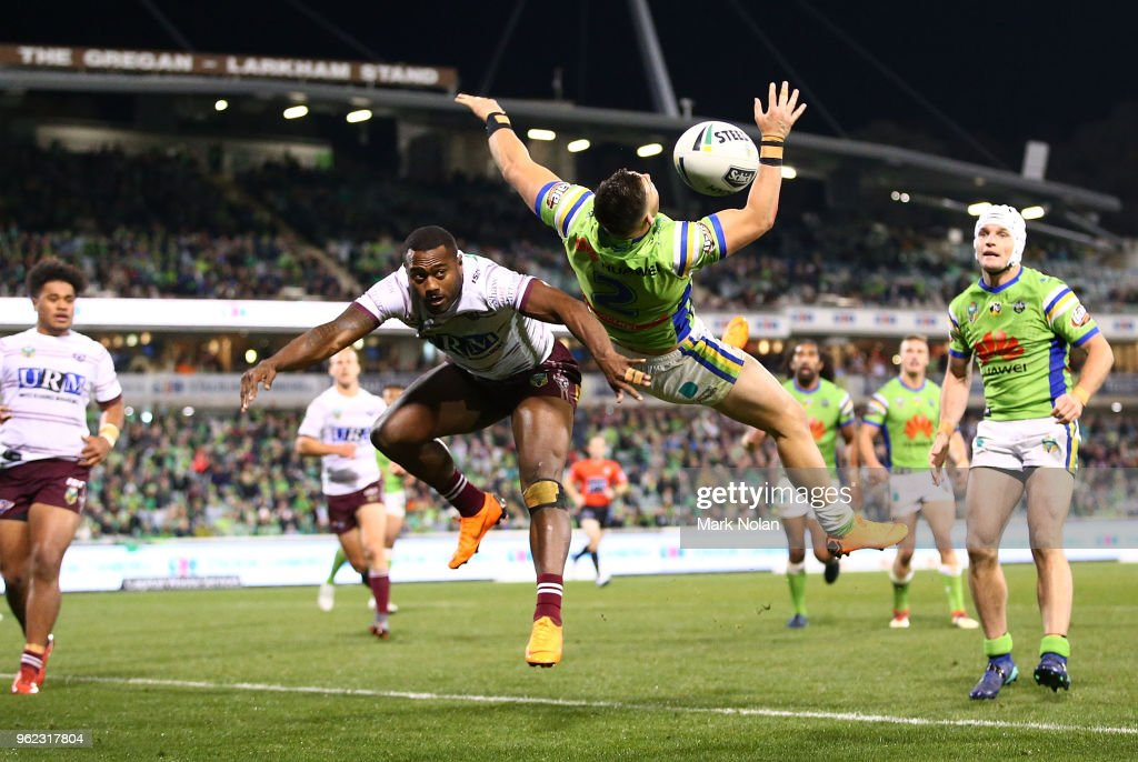 Akuila Uate of the Eagles and Nikola Cotric of the Raiders contest a high ball during the round 12 NRL match between the Canberra Raiders and the Manly Sea Eagles at GIO Stadium on May 25, 2018 in Canberra, Australia.